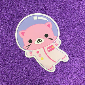 by Bored Inc.This durable, vinyl Space Kitty Sticker is waterproof with an outdoor life of 3-5 years and is even dishwasher safe. Please note that due to everyone's monitor displaying differently, the colors you see may vary. Measures approximately 3 inch tall.