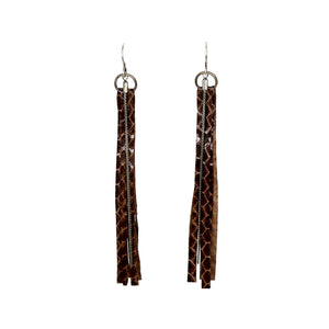 By Brandi Kruse  Materials: Brown Snakeskin and Vintage Chain  Measures: 4.5 inches long.