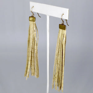 By Brandi Kruse Materials: Cream Snakeskin Tassels Measures: 4 inches long.