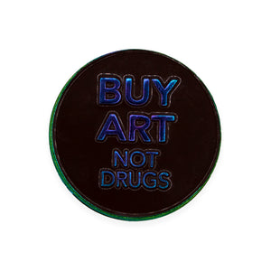 "Seriously though. Buy Art, Not Drugs Lapel Pin. Die Struck Anodized Rainbow Metal Lapel Pin with metal backing. Measures 1.25"" round. Please note that due to everyone's monitor displaying differently, the colors you see may vary."