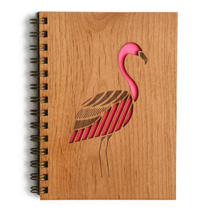 By Cardtorial. Each Flamingo Journal is engraved using a laser cutter that precisely carves out each unique wood cover. Sourcing local sustainable wood and hand-binding each and every journal ensures all your brilliant ideas are stored for the long term. Measures 5.25 x 7.25 inches.