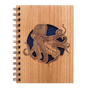 By Cardtorial. Each Octopus Journal is engraved using a laser cutter that precisely carves out each unique wood cover. 160 blank, unlined pages (80 sheets). Front cover laser cut from sustainable wood. Navy leatherette back cover with gold logo. Made in the USA from certified sustainable wood. 5.25 x 7.25 inches.