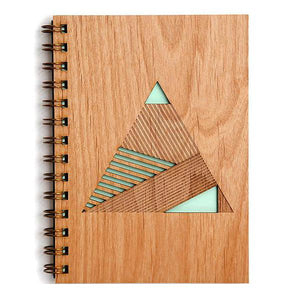 By Cardtorial. The Pyramid Journal is engraved using a laser cutter that precisely carves out each unique wood cover. Sourcing local sustainable wood and hand-binding each and every journal ensures all your brilliant ideas are stored for the long term. Measures 5.25 x 7.25 inches.
