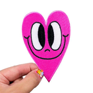 By Chris Uphues. High quality Crosseyed Hot Pink Heart Patch. 100% embroidered, iron-on. Measures approximately 4 x 2.75 inches. Also available in store at FOLD Gallery in DTLA.
