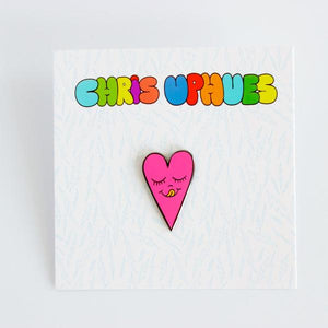 By Chris Uphues. This Neon Pink Heart Pin is made with super shiny black nickel and filled with smooth, high quality, enamel in neon pink and fluorescent orange. Pin comes with a rubber clutch for extra grip and mounted on Chris Uphues packaging. Perfect for gifting! Pin measures 1 inch tall. Also available in store at FOLD Gallery DTLA.