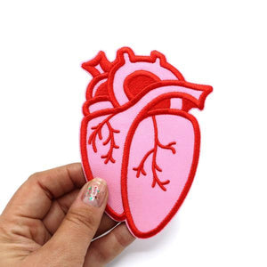 By City of Industry. This embroidered twill Anatomical Heart Patch comes with an iron-on backing, so it's easy to wear your heart on your sleeve (or on your bag, or back pocket, or anywhere else). Measures approximately 4.5 inch by 3.25 inch in size.