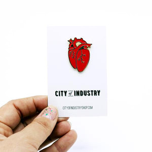 By City of Industry. An Anatomical Heart Pin with gold plating. Measures approximately 1.25 inch long. Also available in store at FOLD Gallery.