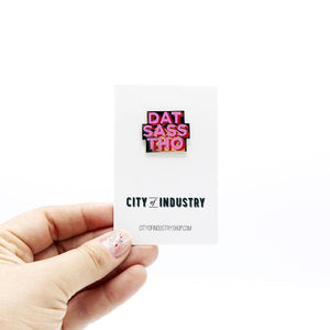 By City of Industry. Let's be clear: Sass is not a bad thing. We know you've got wit, and I have a sneaking suspicion that you've got style. Wear your sass on your sleeve. Cloisonne Dat Sass Pin with gold plating. Measures approximately 1 inch wide. Also available in store at FOLD Gallery in DTLA.