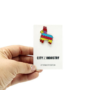 By City of Industry. Bring a little party wherever you go with this colorful Pinata Pin! Cloisonne pin with gold plating. Measures approximately 1.25 inch by 1 inch in size. Also available in store at FOLD Gallery DTLA.