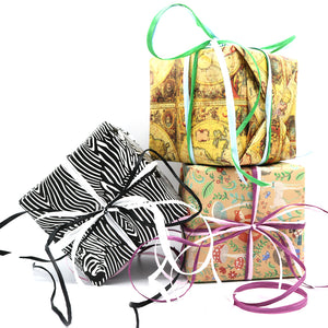 We will gift wrap your item into the corresponding box size with the wrapping paper of your choosing along with two colors of raffia ribbon. Our custom gift wrapper will choose those depending on which colors are available at time of wrapping.