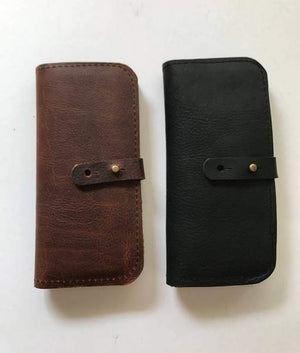 By Hawks & Doves. Leather Check Wallet with Zip Pouch in Dark Brown. This wallet is constructed with full grain oil tanned leather. The leather is treated with oils and waxes which keep it conditioned for a long time and allow the leather to wear in and age wonderfully. Button stud closure. Also available in store at FOLD Gallery DTLA.