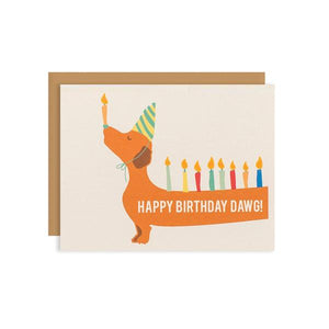By Ilootpaperie. This folded Bday Candle Dawg Card is printed on premium, rich and luxurious cream linen 100lb cardstock. Doxie dog's backside and tail extends to the back of the card (not pictured). Inside is blank for a personal message. High quality, tan envelope with square flap included. Measures 4.25 x 5.5 inches. FOLD Gallery Dtla.