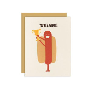 By Ilootpaperie. You're a Wiener Card. This folded card is printed on premium, rich and luxurious cream linen 100lb cardstock. Inside is blank for personal message. High quality, tan envelope with square flap included. Measures 4.25 x 5.5 inches. FOLD Gallery Dtla.
