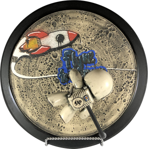 "Tagstronaut: Fly Me to the Moon  Original Handmade Ceramic Artwork by John Hamilton  Measures 14.5"" Round x 7"".   Medium: Handmade Ceramic Artwork - HandBuilt or Thrown on a wheel, glazed and fired by the artist."
