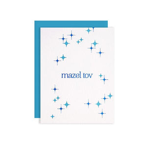 by Kiss and Punch Designs by Julie Stewart. Celebrate a marriage, mitzvah, birth or other special occasion with this Mazel Tov Blue Foil Card! Paper - printed on Crane Lettra 110 lb. paper. Color - blue foil and letterpress. Envelope - A2 blue envelope. Packaging - individually wrapped in a cellophane sleeve. Also available in store at FOLD Gallery DTLA.