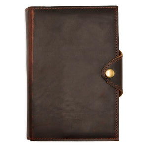 By Kodiak Leather. The Drifter Leather Journal in Dark Walnut is made from Full Grain leather and complete with a snap button closure, this journal is the ultimate gift item for the world traveler or home body. 210 blank pages.Handmade artisan paper. Refillable. Measures 5 x 7 x 2.5 inches.