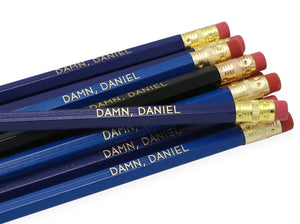 by LZ Pencils. Listing is for one Damn Daniel Pencil. All type is set by hand and lovingly hand-pressed onto each and every pencil. Pencils write in standard #2 gray graphite, perfect for gifting. PLEASE NOTE COLORS ARE RANDOM AND WILL VARY FROM WHAT IS PICTURED.