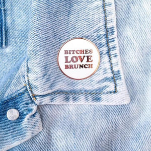 By Little Arrow. Bitches Love Brunch Lapel Pin on denim jacket.