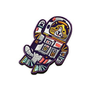 By Little Friends of Printmaking. ZOOM! Stitch this embroidered Astro Cat Patch onto your jacket (or sure, just iron him on, you lazybones) and let him bravely accompany you on all your adventures (in outer space, or at the beach, or at the movies)! Measures 3 x 4.5 inches.