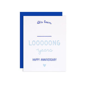By Loudhouse Creative. Anniversary Write In Card features two-color letterpress printing, hand-drawn illustrations, 100% brilliant white cotton paper, blank inside and matching blue envelope cello sleeve packaging. Hand-printed on an antique letterpress in Los Angeles, California.