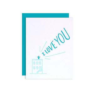 By Loudhouse Creative. I Love You Rooftop Card: two-color letterpress printing, hand-drawn illustrations, 100% brilliant white cotton paper, blank inside, matching teal envelope, cello sleeve packaging. Hand-printed on an antique letterpress in Los Angeles, California. Folded card measures 4.25 x 5.5 inches. Also available in store at FOLD Gallery DTLA.