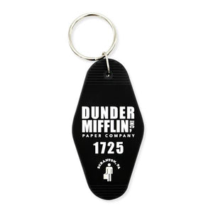 By Loudmouth Pin Co. Dunder Mifflin Keychain. Black rubber keychain measures approximately 3.5 x 2 inches. Comes with a 1 inch metal keyring.