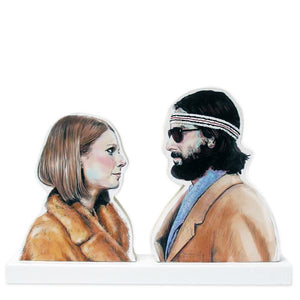 "By Lucky Jackson. Margot & Richie Illustrated Wooden Standee: Proudly display this illustrated standee in your home, office, dashboard. One-of-a-Kind Handmade Standee Stand-Up Illustration. Handmade illustration mounted on 3/8"" birch panel. Sealed with 3 coats of varnish. Measures 6 inch tall x 8.75 inch wide. Also available in store at FOLD Gallery DTLA."