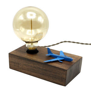by Luke Hobbs Design  The vintage inspired Bomber Airplane Touch Lamp is 'touch' - controlled. Simply 'touch' any part of the airplane to control the lamp (on/off/three levels of brightness). Features a handcrafted dark wood base, porcelain socket and decorative reproduction cloth cord. Large Globe Filament Bulb included.  Approximate Dimensions: 9 x 9 x 4.5 inches (including the light bulb)