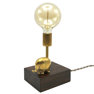 by Luke Hobbs Design  The vintage inspired Mr. Elephant Touch Lamp is 'touch' - controlled. Simply 'touch' any part of the brass elephant to control the lamp (on/off/three levels of brightness). Features a handcrafted dark wood base, antique brass finish, porcelain socket and decorative reproduction cloth cord. Large Globe Filament Bulb included.  Approximate Dimensions: 15 x 7 x 5.5 inches (including the light bulb)