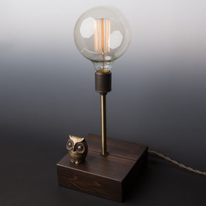 by Luke Hobbs Design. The Mr. Owl Touch Sensor Lamp is 'touch' controlled. Simply 'touch' any part of the brass owl to control the lamp (on/off/three levels of brightness). The lamp features an antique reproduction cloth covered cord, porcelain socket, handcrafted wood base, exposed filament large globe bulb. Product Dimensions 6.5 x 6.5 x 17 inches high