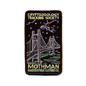 By Maiden Voyage Clothing Co. Mothman Rectangle (Bridge) Patch: This Cryptozoology Tracking Society patch is reminiscent of the old fashioned National Park patches, but features a cryptid character in their natural habitat! Show your support for the Cyrptozoology Tracking Society! Iron-on (sewing still recommended). Also available in store at FOLD Gallery DTLA.