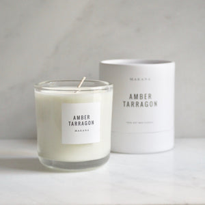 By Makana Candles. Amber Tarragon Candle: Resinous amber accented by vanilla and fennel, unveiling a heart of fresh tarragon, tuberose and basil, and finished with an accord of sensuous woods. Hand-poured in-house in small batches using simple, clean ingredients.