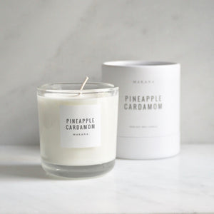 By Makana Candles Pineapple Cardamom Candle: This refreshing scent starts with pineapple, revealing a hint of calamansi lime. Spicy-sweet notes of cardamom and black pepper are uncovered and finished with creamy vanilla. Hand-poured in-house in small batches using simple, clean ingredients.