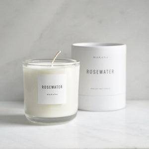 By Makana Candles. Rosewater Candle: A soft garden rose fragrance with a citrus undertone. Notes of geranium and violet are revealed, while vetiver and rosewood lightly ground this beautiful scent. Hand-poured in-house in small batches using simple, clean ingredients.