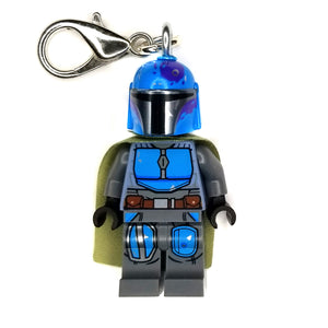 By Miss Brixx. Lego® Minifigure Star Wars Mando Blue Gray Keychain. Silver color Lobster Clasp connectors. Lego figure measures approximately 2cm x 4cm.