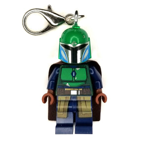 By Miss Brixx. Lego® Minifigure Star Wars Mando Green Blue Keychain. Silver color Lobster Clasp connectors. Lego figure measures approximately 2cm x 4cm.