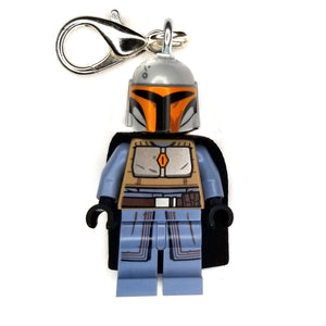 By Miss Brixx. Lego® Minifigure Star Wars Mando Orange Blue Keychain. Silver color Lobster Clasp connectors. Lego figure measures approximately 2cm x 4cm.