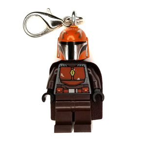 By Miss Brixx. Lego® Minifigure Star Wars Mando Orange Brown Keychain. Silver color Lobster Clasp connectors. Lego figure measures approximately 2cm x 4cm.