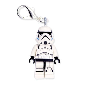 By Miss Brixx. White Stormtrooper Keychain. Lego® Minifigure Star Wars keychain. Silver color Lobster Clasp connectors. Lego figure measures approximately 2cm x 4cm. FOLD Gallery Dtla.