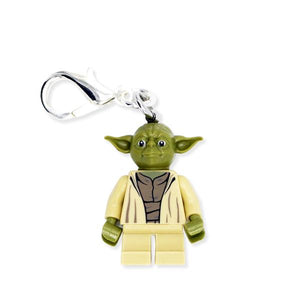 By Miss Brixx. Yoda Keychain. Lego® Minifigure Star Wars keychain. Silver color Lobster Clasp connectors. Lego figure measures approximately 2cm x 3cm. FOLD Gallery Dtla.