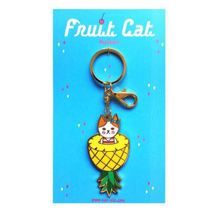 By Naoshi. Hard enamel Pineapple Cat Keychain. Comes on a backing card in a plastic sleeve. The Pineapple Cat measures 2.8 x 1.4 inches. Also available in store at FOLD Gallery DTLA.