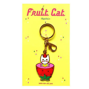 By Naoshi. Strawberry Cat Keychain. Hard enamel plus gold metal keychain. Comes on a backing card in a plastic sleeve. The Strawberry Cat measures 2.2 x 1.4 inches.