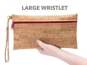 By Natalie Therese. The BE READY Large Wristlet with Butterscotch Zipper is the perfect accessory! Handmade from eco-friendly cork. Organic cotton lining. Removable wristlet strap. Zipper closure in butterscotch color. Gold Hardware. Measures 10W x 5.5H inches. FOLD Gallery Dtla.