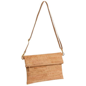 By Natalie Therese. Be Flexible Fold Over Cross Body Bag that doubles as a clutch. Handmade from eco-friendly cork. Cork fabric. Eco-friendly + PVC-free faux leather. Organic cotton lining. Two inside slip pockets. Adjustable Cork Strap. Zipper closure. Gold Hardware. Measures 10 x 7 inches (Folded). FOLD Gallery Dtla.