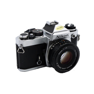 Vintage Nikon FE 35mm Film Camera with Nikon 50mm 1:1.8 Series E Lens and Instruction Manual