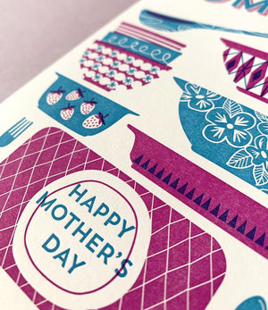 By Paper Parasol Press. Send your mom some pyrex cheer for Mother's Day! Dishing Out the Love Card details: A2 Size. 2 color letterpress printed card. Blank interior. Comes with a light purple envelope. Printed in the USA.