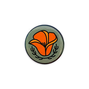 By Poppy and Quail. Poppy Button. Add a little flair to your jacket, backpack or tote with this pin-back button featuring a California Poppy. Measures 1.25 inches. Also available in store at FOLD Gallery DTLA.