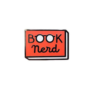 "By Rather Keen. Hard enamel Book Nerd Pin. Bright red enamel and black metal with black rubber clasp. ""When in doubt, go to the library."" —Hermione Granger. Measures 1 inch wide. Also available in store at FOLD Gallery."