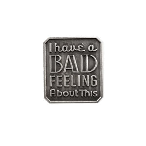 By Rather Keen. I Have a Bad Feeling About This - Star Wars Quote Pin. For when you're having bad feelings. Variations of this line can be heard in every Star Wars movie. Raised metal design (no enamel) in antique silver finish. Rubber clasp. Measures 7/8 x 3/4 inch (21 x 23 mm). Also available in store at FOLD Gallery DTLA.