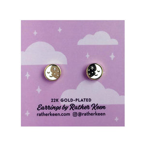 By Rather Keen. Sleepy Moon Stud Earrings. 22k gold-plated stud earrings. Nickel-Free! Please note that due to everyone's monitor displaying differently, the colors you see may vary. Measures 10 mm wide.